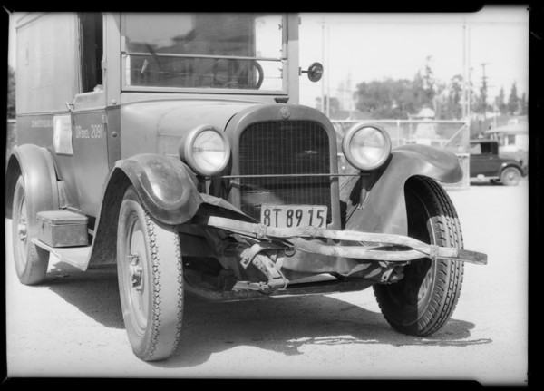 Cosmopolitan Laundry truck, damage to front, Southern California, 1932