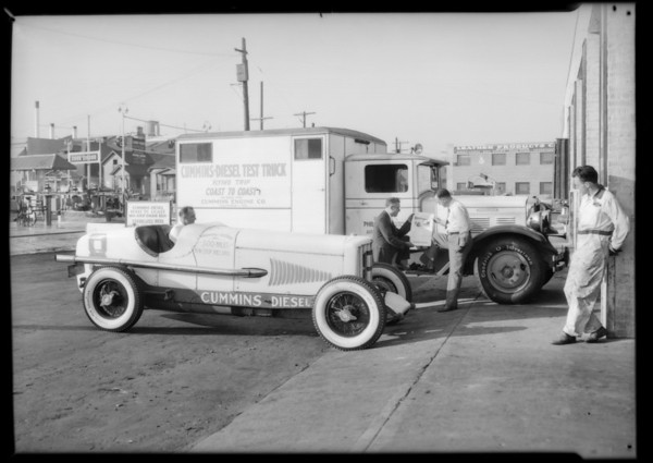 Truck and rising car, Southern California, 1931