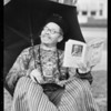 """Gin Chow"" reading ""Old Mother Mexico"", Southern California, 1932"