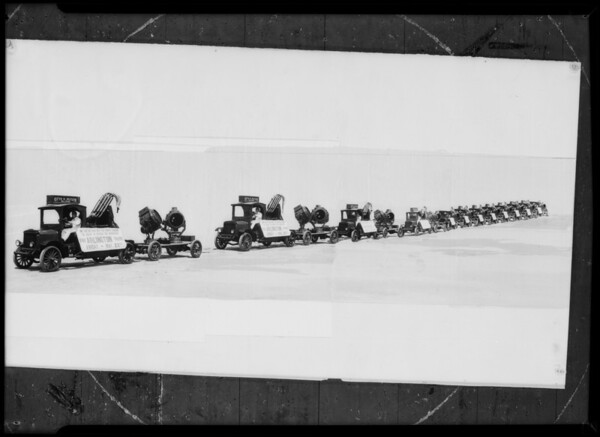 Composite of fleet of power wagons, Southern California, 1931