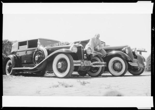 Vince Barnett with 'Vogue' equipped cars, Southern California, 1934