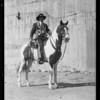 Man on horse to be auctioned, Southern California, 1931