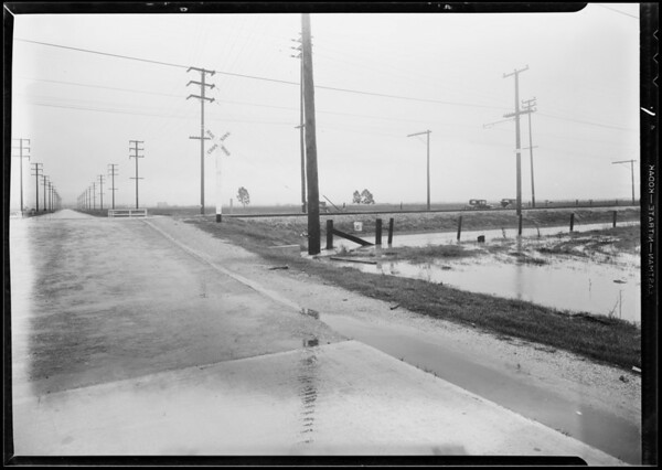 Solon Riddick, assured, cars and intersection, 190th Street and Normandie Avenue, Southern California, 1931