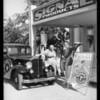 Mr. & Mrs. L.J. Pierce at Signal station, Wilshire Boulevard & Swall Drive, Beverly Hills, CA, 1933