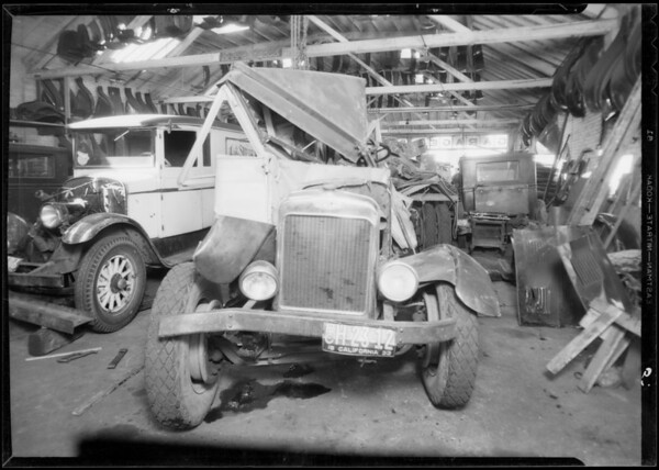 Wrecked truck and intersection near 9th Street and Stanford Avenue, Southern California, 1933