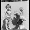 Little girl & dahlias, Southern California, 1933
