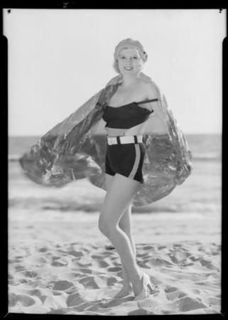 Cellophane blanket on bathing girl, Southern California, 1932