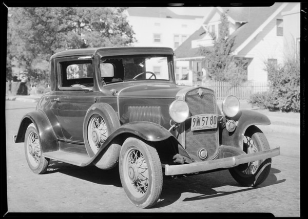 Damaged Chevrolet coupe, Mr. Koch assured, and intersection of Riverside Drive and Los Feliz Boulevard, Southern California, 1932