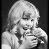 Girl eating ice cream from 5¢ cup, Mary Alice, Southern California, 1932