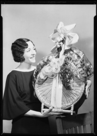 Mrs. Paige and basket of fancy fruits, Southern California, 1932