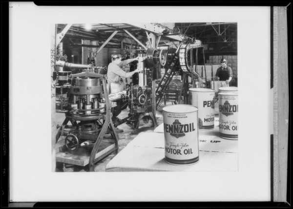 Canning machine and cans, Southern California, 1935