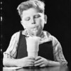 Boy eating ice cream soda, Southern California, 1932