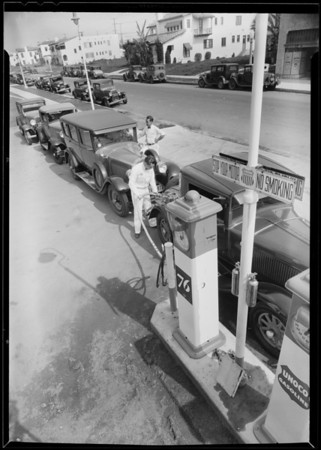 Line up of cars at 76 pump, West 3rd Street & South Detroit Street, Los Angeles, CA, 1932