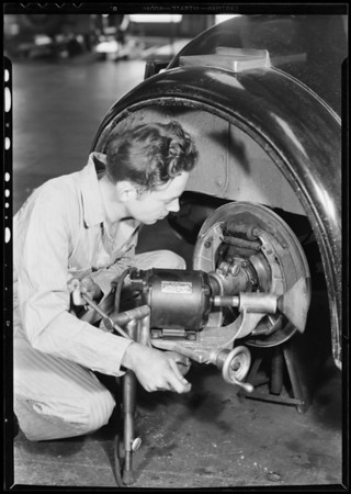 Grinding brake shoe, Southern California, 1932