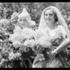 Spanish and Dutch girls with dahlias, Southern California, 1932