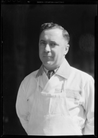 Portrait of Mr. Reno Guasti, manager of meat market at 3915 West 10th Street [3915 West Olympic Boulevard], Southern California, 1935