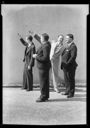 Executives welcoming ship in at harbor on roof of building, Southern California, 1932