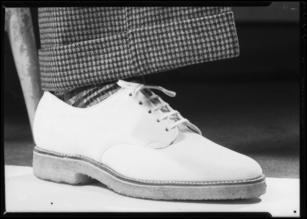 White sport shoe and trouser leg, Southern California, 1935