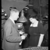 Mrs. Rogers and Mr. Weaver in coffee roasting room, Southern California, 1935