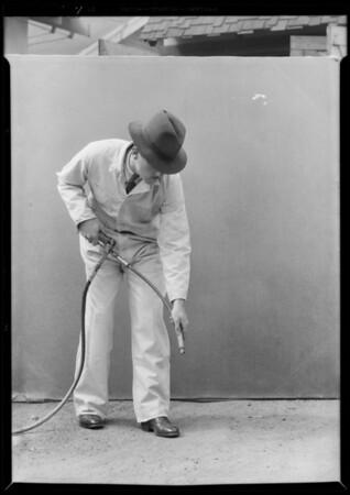 Pipe end, man holding Alemite gun, Southern California, 1932