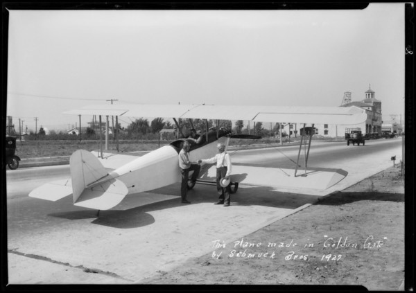 Industrial buildings in Golden Gate Park and airplane, Southern California, 1927