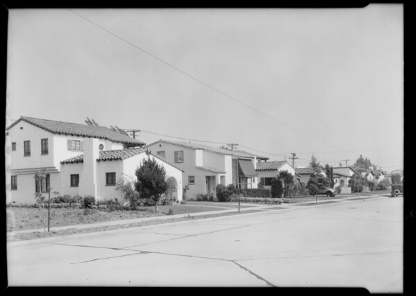 Row of apartment buildings and homes, Southern California, 1933