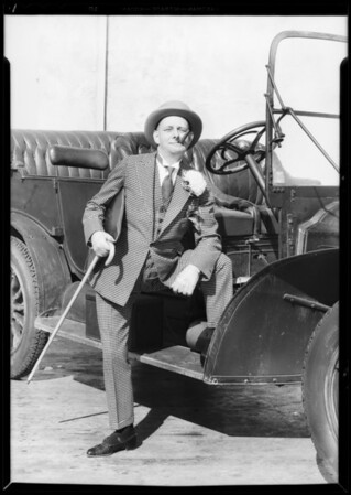 """Al"" in bowery outfit with 1907 Packard, Southern California, 1933"