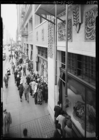 Crowd looking at flower windows, Southern California, 1934