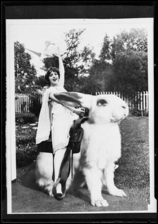 Prominent people, theatrical, Helen Ferguson & rabbit, Southern California, 1927