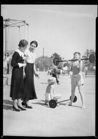 Miss Pyle, Miss Ashtor, and Albert Barker in Exposition Park, Los Angeles, CA, 1934