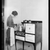 Housewife at stove, Southern California, 1928