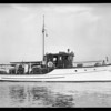 Mr. Hunt of Pioneer Paper on his yacht, Southern California, 1927