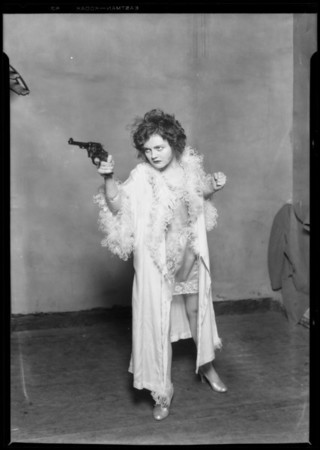 Nancy Carroll with gun, Music Box Theater, Southern California
