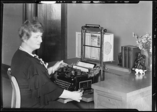 Demonstrating use of typewriter work holder, Los Angeles, CA, 1933