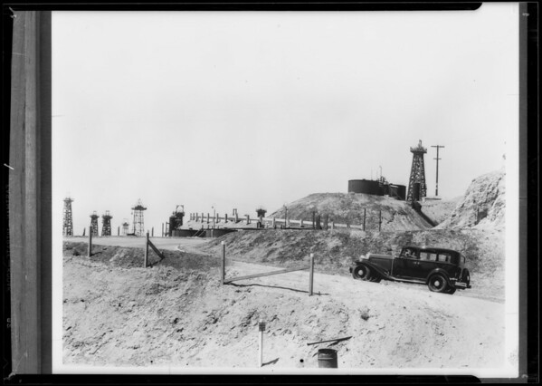 Oil truck and plane and oil field, Southern California, 1933