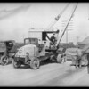 Trucks laden with equipment for Russia at Asbury Scales, Wilmington, Los Angeles, CA, 1927