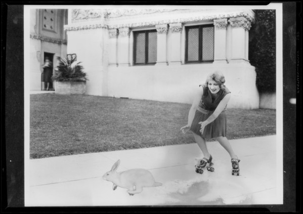 Girl on skates chasing rabbit at Figueroa Playhouse, 940 South Figueroa Street, Los Angeles, CA, 1928