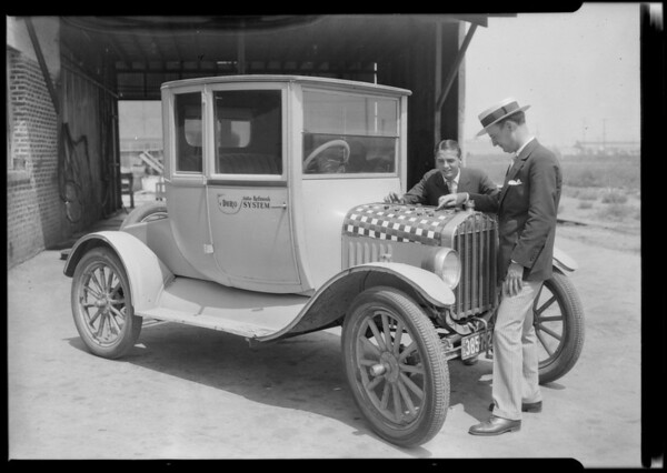 Playing checkers on car, Southern California, 1924