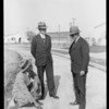 Mr. Shaw inspecting pavement, Southern California, 1927