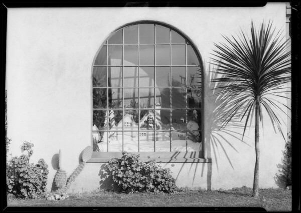 Alfred Carter's shop and Christmas window at home, Southern California, 1933