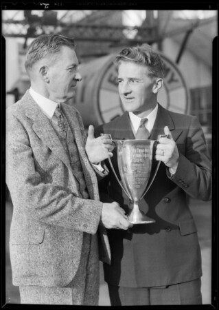 Mr. Smith and other man with loving cup, Southern California, 1932
