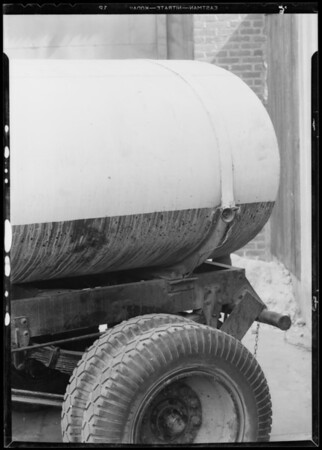 Foot and slide marks on gas tank trailer, Southern California, 1934