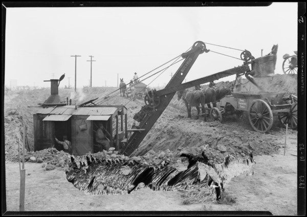 Salesmen and airplane, apartment house on Leimert Boulevard, steam shovel at work, Southern California, 1929