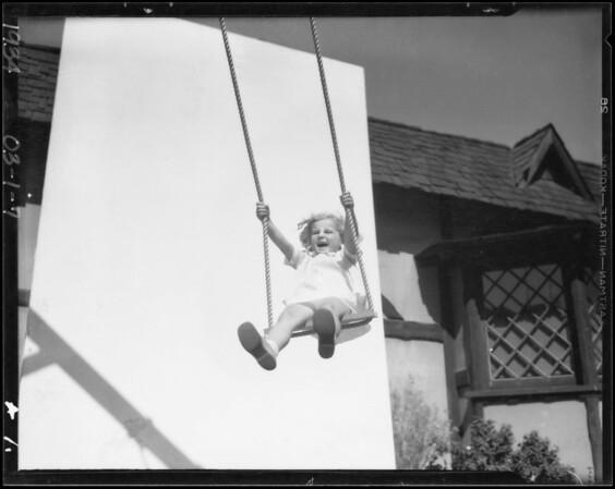 Little girl in swing, Marilyn Bourne, Southern California, 1934