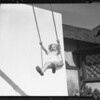 Little girl in swing, Marilyn Bourne, Southern California, 1934