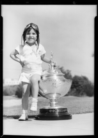 Sheila Brown & trophies, age 4 years, 1000 hours in air, Southern California, 1933
