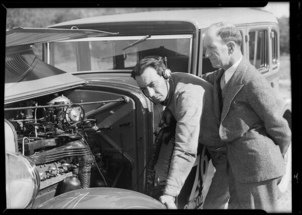 Racing drivers and microphone on car, Southern California, 1932