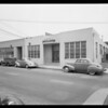 Exteriors of former factory and present factory, Southern California, 1940