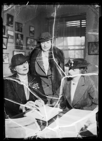 Mrs. Walter P. Story, etc., signing papers, Los Angeles, CA, 1936