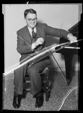 Man playing musical saws at University of Southern California, Los Angeles, CA, 1936